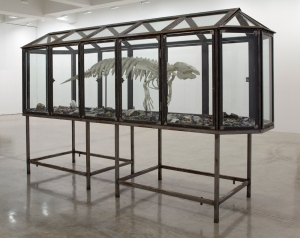 Mark DION Trichechus manatus latirostris 2013 plastic skeleton, tar, found objects in steel and glass case 72 x 40 x 176 inches