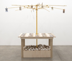 Meschac GABA Bureau d'échange [Exchange Office]: Cotton, 2014 wood table, metal umbrella frame, assorted banknotes, clothespins, cotton stocks