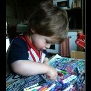 At age two years and three months, Arrian worked for five days to create this 18- x 24-inch painting. He used Crayola markers sometimes drawing with the right hand and sometimes with the left.
