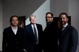 Edward Dolman, second from left, chairman and chief executive of Phillips, with, from left, the house's art experts Jean-Paul Engelen, Robert Manley and Scott Nussbaum. Credit Alex Welsh for The New York Times